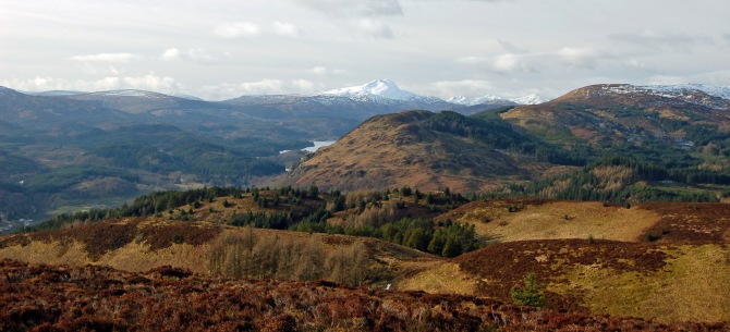 Looking west over Aberfoyle glimpsing Loch Ard and Ben Lomond in the background