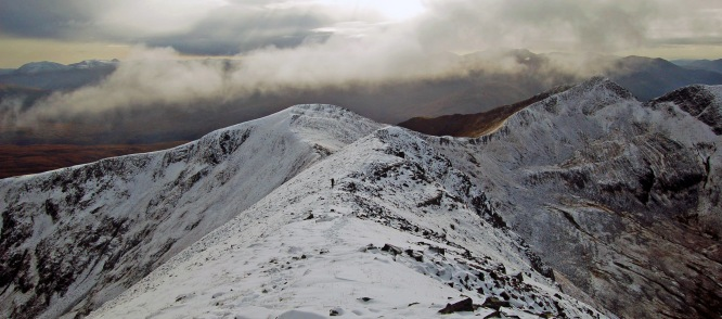 Looking west from Binnean Mor in the Mamores as a walker heads towards Na Gruagaichean. (early Nov 09)