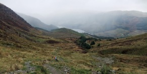 As we look back down the traverse to the stile I notice that the forecast is not living up to expectations with the cloud drifting up Loch Lubnaig...and the drizzle has begun.