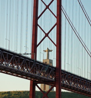 """A giant statue of Jesus overlooks the bridge. This is seriously scary, the required presence of a major religious figure an indicator of the crossing's structural integrity. """