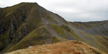 The north face of Am Bodach. We should follow the sharp edge (centre shot) all the way to the summit. Instead we keep on at the same level and attempt the steep boulder field. That's enough laughing in the back row!